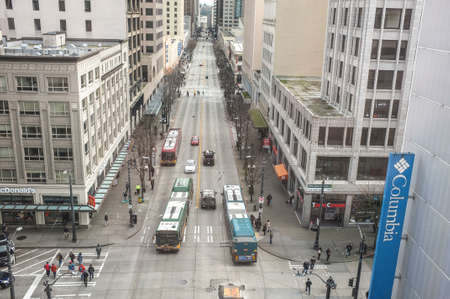 A high rise street scene with transit buses
