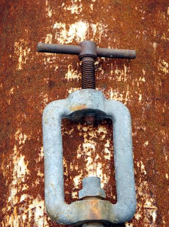 Rusty screw on rusty metal plate