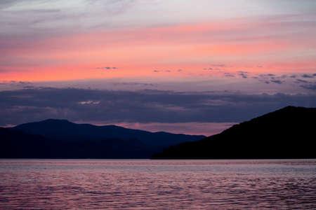 Calm colorful sunset on the Danube in Donji Milanovac, Serbia