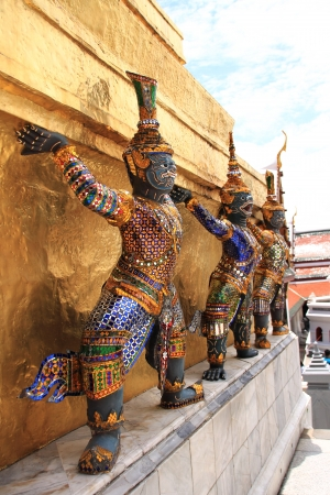 Thai giant stand around gold pagoda in Wat Phra Keaw, Bangkok ,Thailand