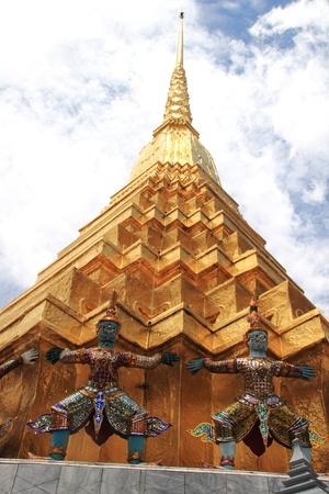 Thai giant stand around gold pagoda in Wat Phra Kaew, Bangkok ,Thailand Stock Photo