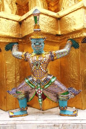Thai giant stand around gold pagoda in Wat Phra Kaew, Bangkok ,Thailand Editorial