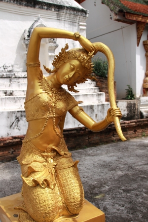 Goddess of the earth squeezing water from her hair to protect the Buddha after enlightenment  Wat Prasat, Chiang Mai, Thailand photo