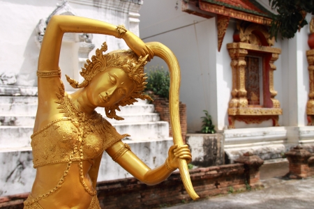 Goddess of the earth squeezing water from her hair to protect the Buddha after enlightenment  Wat Prasat, Chiang Mai, Thailand Stock Photo