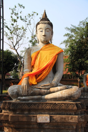 Ancient Buddha statue at Wat Yai Chaimongkol in the historical city, Ayutthaya, Thailand photo