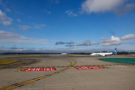 Seattle, WA/USA-9/16/19:Two Alaska Airlines jet airplanes ready to take off on the runway at the Seattle airport.