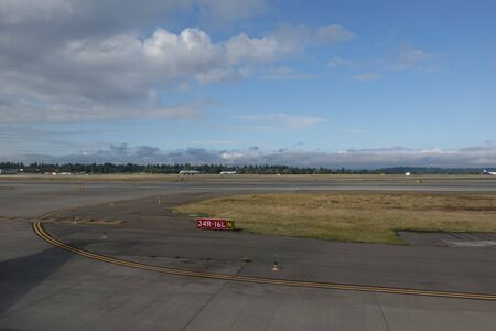 Seattle, WA/USA-9/16/19: A view of the runway and jet airplanes ready to takeoff at the Seattle airport. Stock Photo