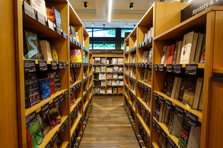 Seattle,WA/USA-9/15/19: An aisle of wooden book shelves at the original University District Amazon Bookstore.