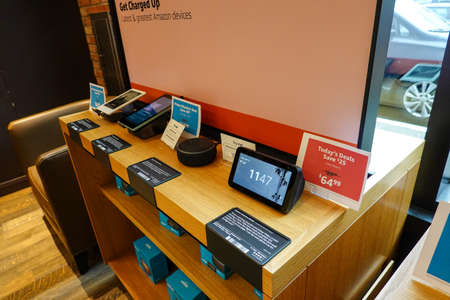 Seattle, WA/USA-9/15/19: A display of Amazon electronic devices such as, kindle, echo dot, tablet, and echo show at the original University District Amazon Bookstore in Seattle, Washington.