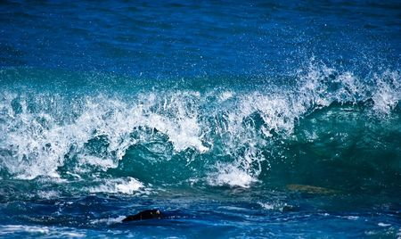 breaking in: Waves breaking in the ocean. Stock Photo