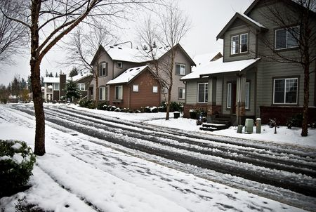 After a night of heavy snow, communities awoke to snow covered streets and homes. photo
