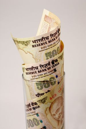 rupee: 500 Rupee Notes in a Glass showing growth
