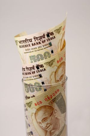 500 Rupee Notes in a Glass showing growth  photo
