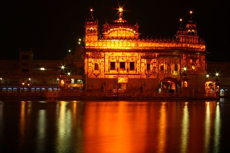 amritsar: The Golden temple in Amritsar, Punjab, India in night. A sacred place thronged by devotees of all religions all round the year from world over Stock Photo