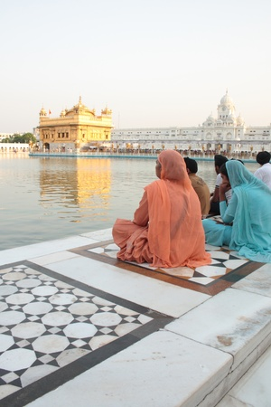 Amritsar, India - June 09, 2011 - A family sitting in the complex of the Golden Temple