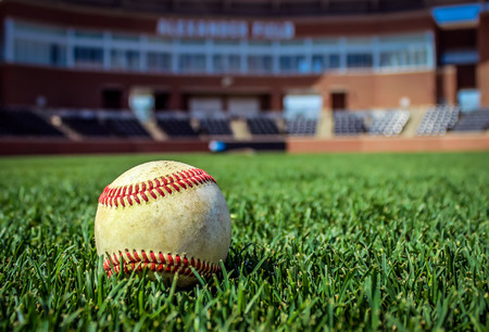baseball stadium: Worn Baseball on Stadium Field