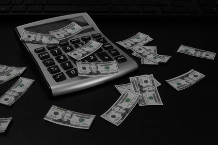 Calculator And Money Reklamní fotografie - 112017409