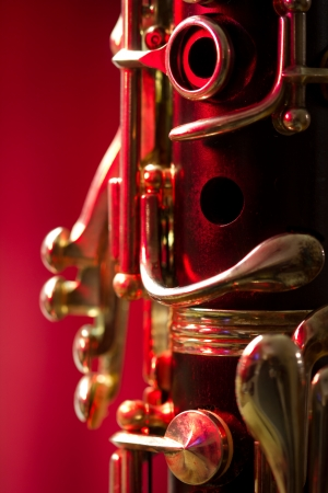 Close-up of a clarinet on a red background