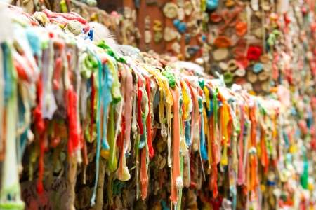 The photograph depicts the Gum Wall tourist attraction in Seattle, Washington.