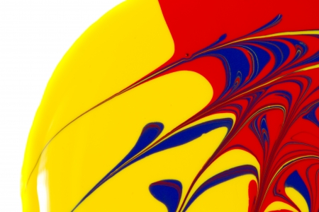 Abstract image of red, yellow, and blue paint swirls