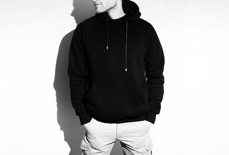 casual hooded top: Blank black hoodie, sweatshirt, mock up isolated. Plain hoody design presentation.