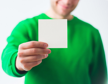 note booklet: man in greenery sweatshirt smile, Hand holding Blank A4 Flyer, DL, A5, square, Invitation, brochure booklet, pamphlet, fold offset paper, design, mock up