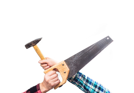 pounding head: guy in a plaid red shirt holding a wood saw and a hammer, crossed, the concept of DIY, repair, handyman,
