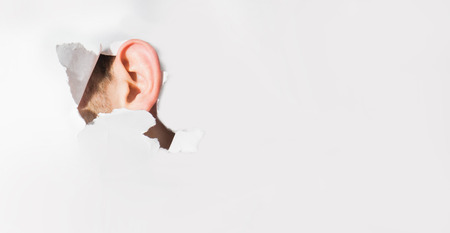 human Ear through a piece of paper, a spy, wiretapping, secrets, secrecy, privacy, on white background, free