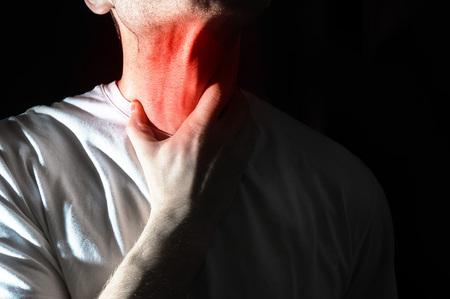 heartburn: The man touches his sore throat, neck, Temperature, runny nose, illness,
