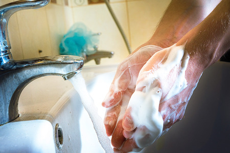 dirt: man wash hands with