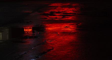 wet road asphalt reflections, red Reklamní fotografie