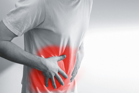 man with stomach pain, Ache, issues, in white shirt, on a background