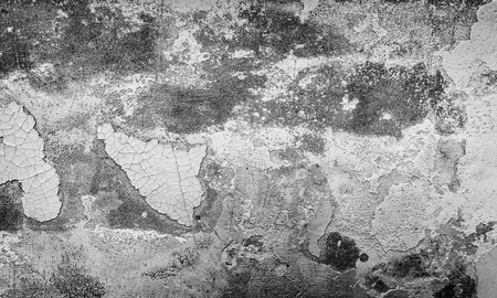 Gray grunge texture of cracked paint, background. Stock Photo
