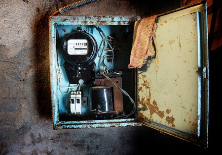 Old Soviet electricity meter on the wall Stock Photo