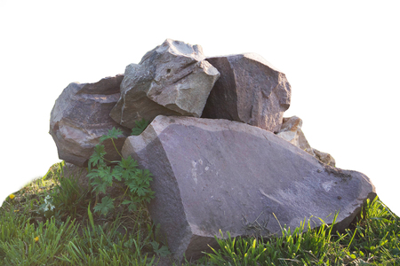 Large stones on green grass isolated