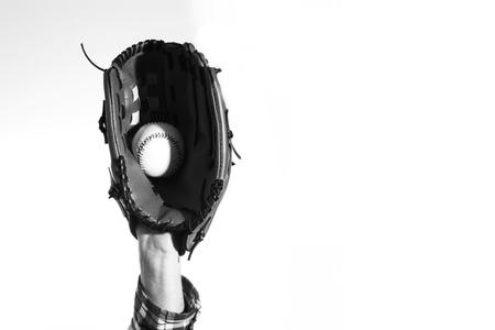 982f906da76 Hand in a baseball glove with a baseball ball on a white Stock Photo