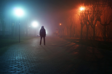 man stand alone at the foggy street Banco de Imagens