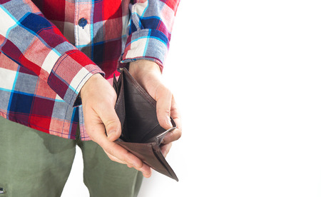 Man with an empty wallet on a white background, not enough money