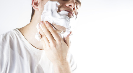 man with shaving foam on his face, Morning ritual operation Stock Photo