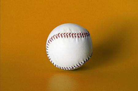 Baseball ball on an orange background