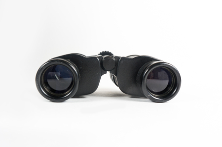 black metallic background: Binoculars on white background isolated, searcher travel equipment