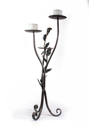 old black metal tall candlestick with candles on a white background isolated
