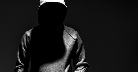 dark mysterious man hoodie, murderer, hacker, anonymus Stock Photo