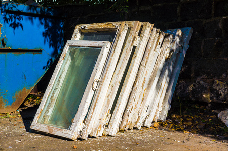 windows frame: old wooden windows in the trash, looking for replacements for new ones Stock Photo