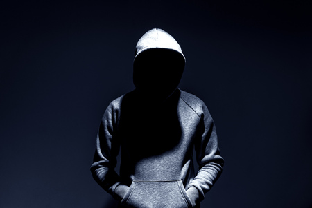 dark mysterious man hoodie, murderer, hacker, anonymus Stock Photo