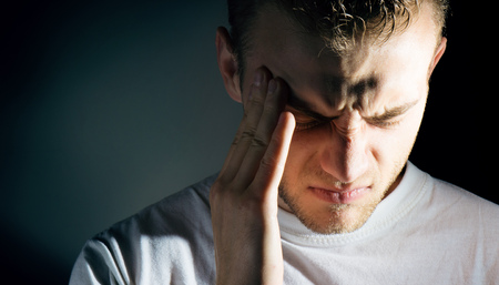man hold his had and suffering from headache, pain, migraine, sad depressed