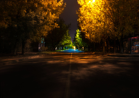 night street in autumn, in europe, small town, night lamps Banco de Imagens