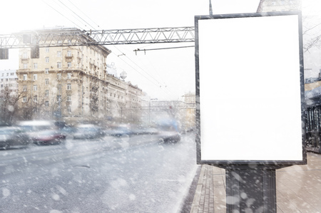 Empty  blank billboard in winter in snowfall, Christmas presentation design