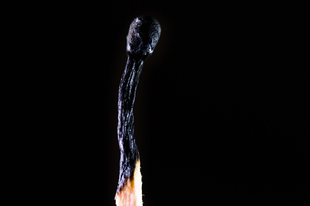 burned out: Burned match on a dark background with smoke
