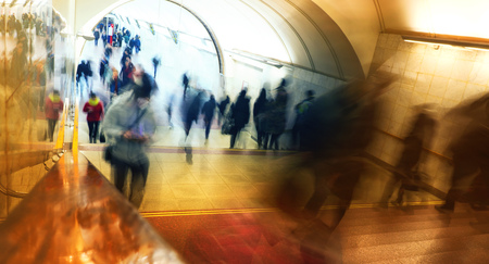 people in the subway will laugh at work, business people go, blurred background Stockfoto